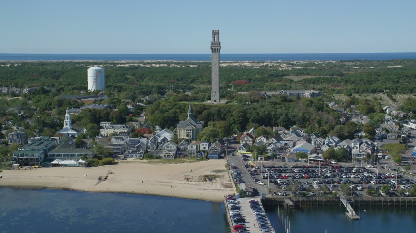 6K stock footage aerial video approaching Pilgrim Monument, Provincetown Town Hall, Provincetown, Massachusetts Aerial Stock Footage | AX143_248