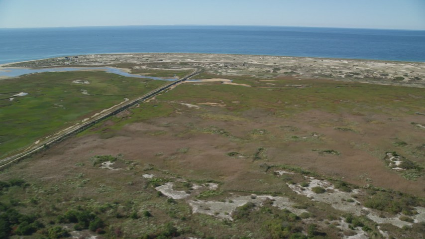 6K stock footage aerial video flying by marshland, Cape Cod, Provincetown, Massachusetts Aerial Stock Footage | AX143_255