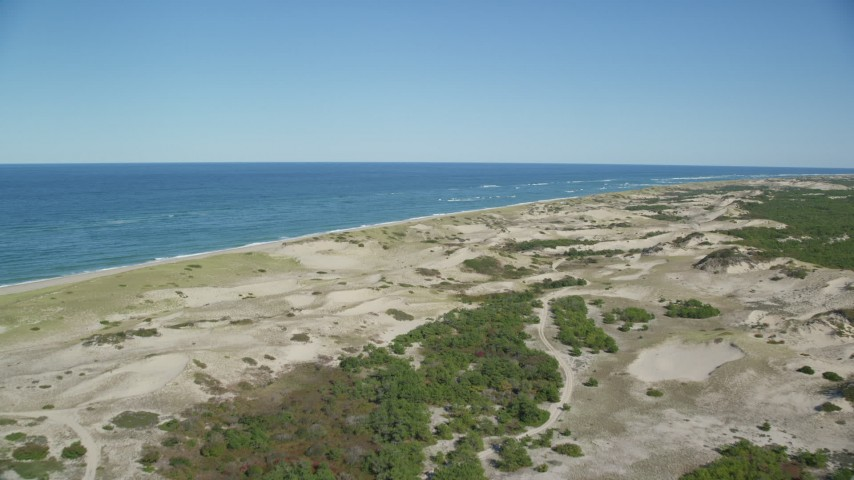 6K stock footage aerial video flying over sand dunes, beach, Cape Cod, Provincetown, Massachusetts Aerial Stock Footage | AX144_001