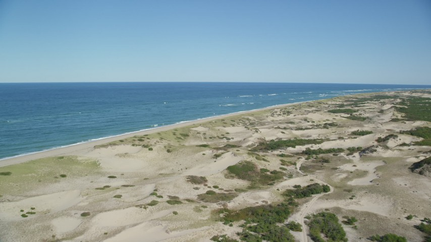 6K stock footage aerial video flying over sand dunes, beach, Cape Cod, Provincetown, Massachusetts Aerial Stock Footage | AX144_002