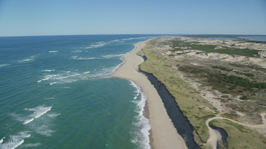6K stock footage aerial video flying over beach, Cape Cod, Provincetown, Massachusetts Aerial Stock Footage | AX144_005