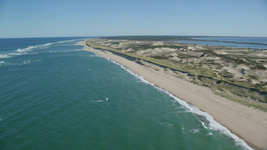 6K aerial video flying by waves crashing on beach, Cape Cod, Truro, Massachusetts Aerial Stock Footage | AX144_008