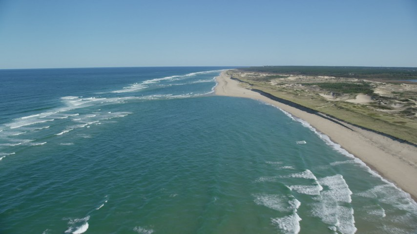 6K aerial video flying over waves rolling onto beach, Cape Cod, Truro, Massachusetts Aerial Stock Footage | AX144_010