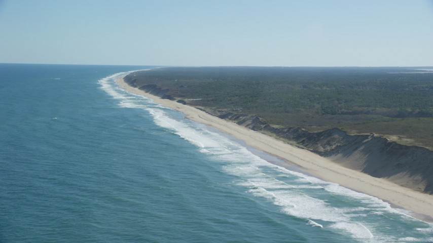 6K aerial video flying by waves crashing, beaches, Cape Cod, Truro, Massachusetts Aerial Stock Footage | AX144_023