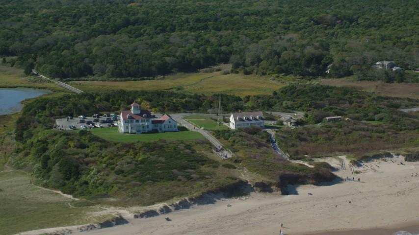 6K stock footage aerial video flying by Coast Guard Beach, Cape Cod, Eastham, Massachusetts Aerial Stock Footage | AX144_033