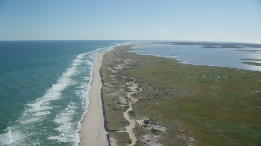 6K stock footage aerial video flying over waves crashing, beaches, marshlands, Orleans, Massachusetts Aerial Stock Footage | AX144_040