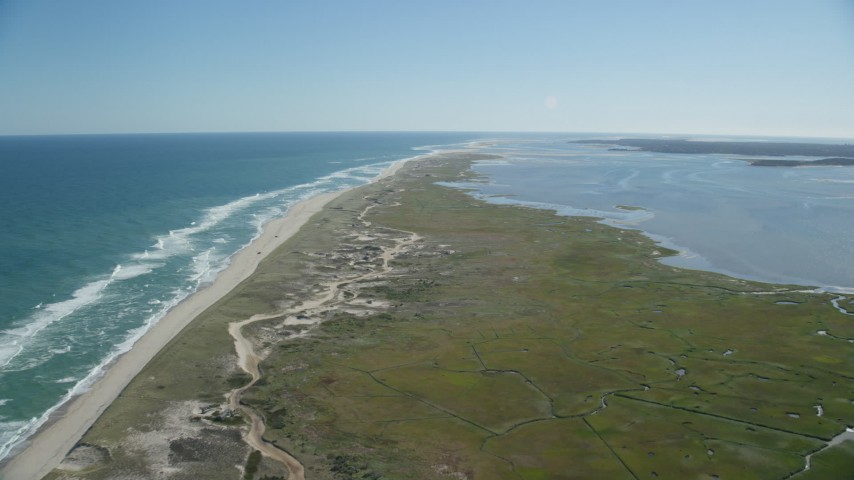 6K stock footage aerial video flying over marshlands, near beach, Cape Cod, Orleans, Massachusetts Aerial Stock Footage | AX144_041