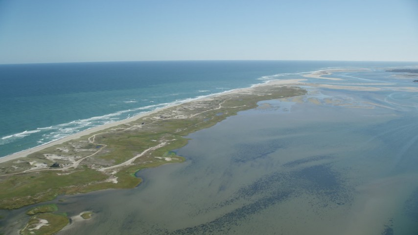 6K stock footage aerial video flying by marshlands, beaches, sand bars at low tide, Orleans, Massachusetts Aerial Stock Footage | AX144_042