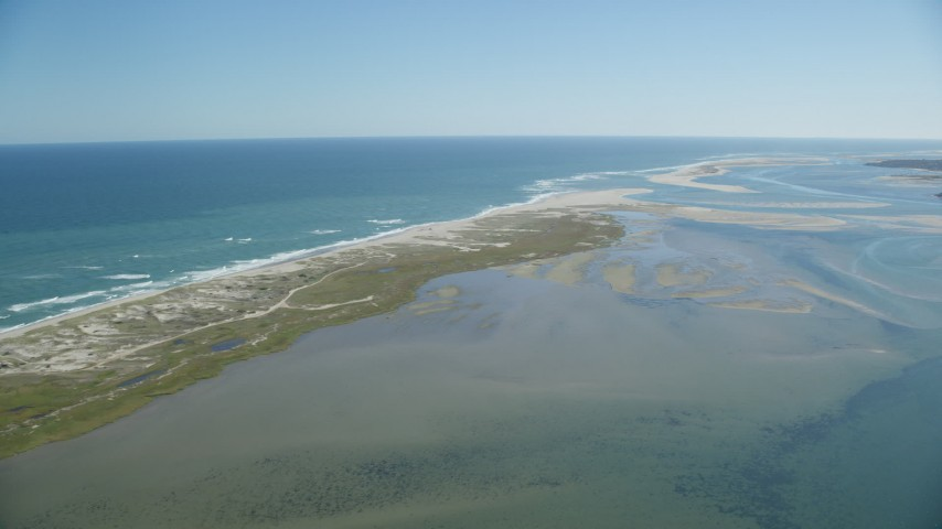 6K stock footage aerial video flying by beaches, marshlands, sands bars at low tide, Orleans, Massachusetts Aerial Stock Footage | AX144_043