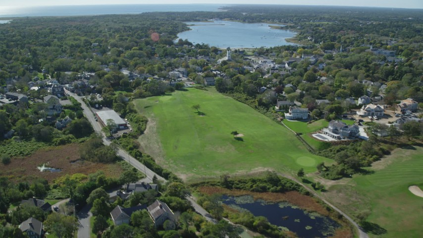 Flying by small coastal town, Cape Cod, Chatham, Massachusetts Aerial Stock Footage | AX144_049
