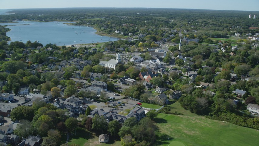 6K aerial video flying by small coastal town, Cape Cod, Chatham, Massachusetts Aerial Stock Footage | AX144_049