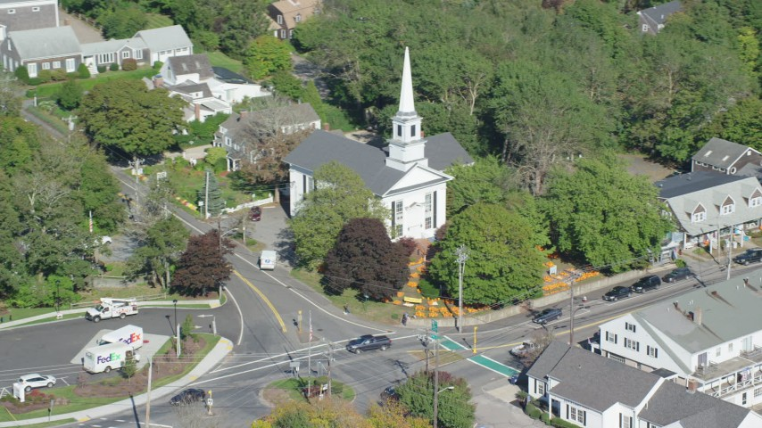 Flying by small town church, colorful trees, Cape Cod, Chatham, Massachusetts Aerial Stock Footage | AX144_051