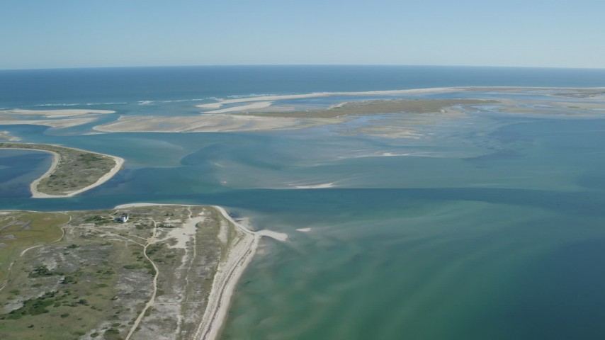 Flying by Monomoy Island, sands bars at low tide, Chatham, Massachusetts Aerial Stock Footage | AX144_054