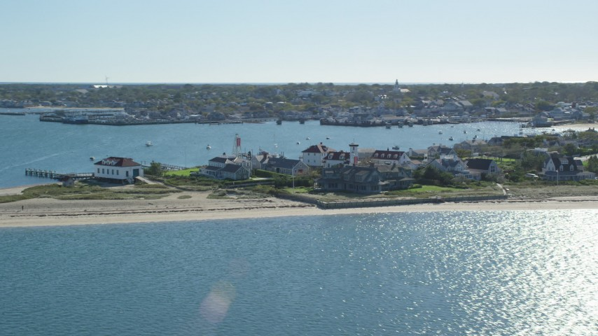 6K stock footage aerial video flying by small island town, Nantucket Harbor Range Lights, Nantucket, Massachusetts Aerial Stock Footage | AX144_075