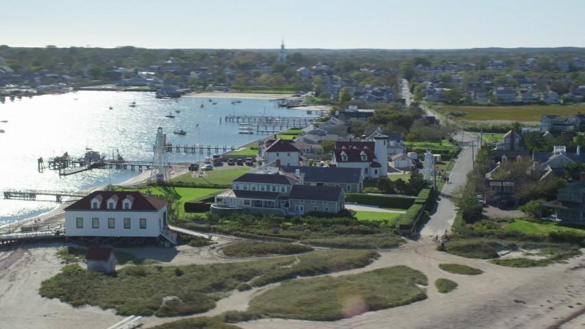 6K stock footage aerial video of beachfront property, Nantucket Harbor Range Lights, Nantucket, Massachusetts Aerial Stock Footage   AX144_076