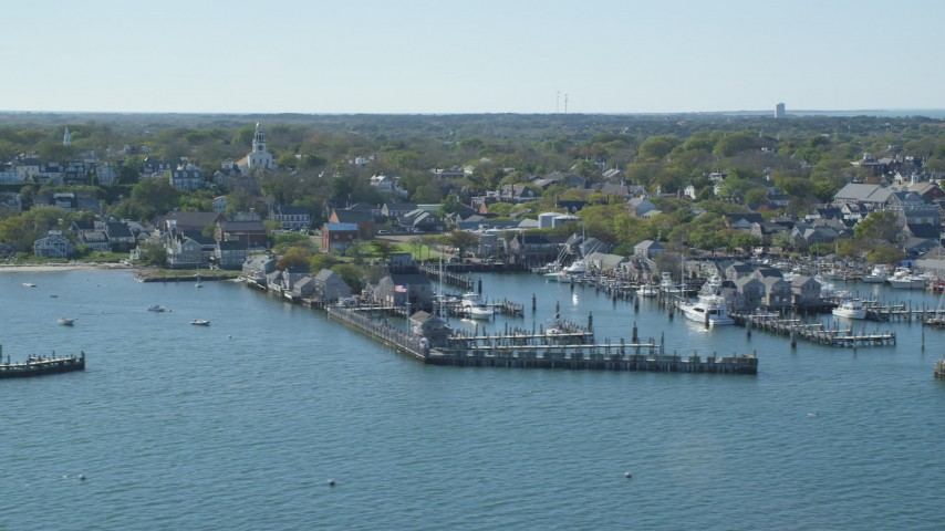 6K stock footage aerial video flying by coastal community, piers, Nantucket, Massachusetts Aerial Stock Footage | AX144_080