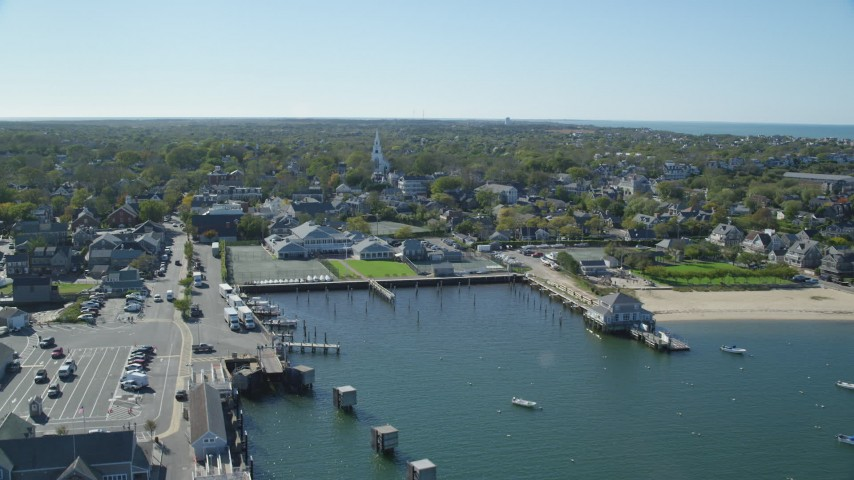 6K stock footage aerial video approaching a small coastal town, from over the water,  Nantucket, Massachusetts Aerial Stock Footage | AX144_082