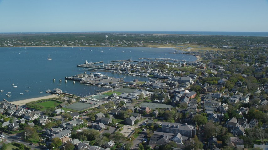 6K stock footage aerial video flying by small coastal town, Nantucket Harbor, Nantucket, Massachusetts Aerial Stock Footage | AX144_086