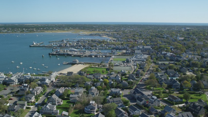 6K stock footage aerial video flying by small coastal town, Nantucket Harbor, Nantucket, Massachusetts Aerial Stock Footage | AX144_087