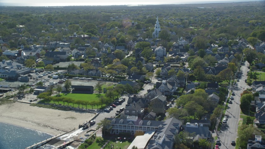 6K stock footage aerial video flying over coastal community, First Congregational Church, Nantucket, Massachusetts Aerial Stock Footage | AX144_092