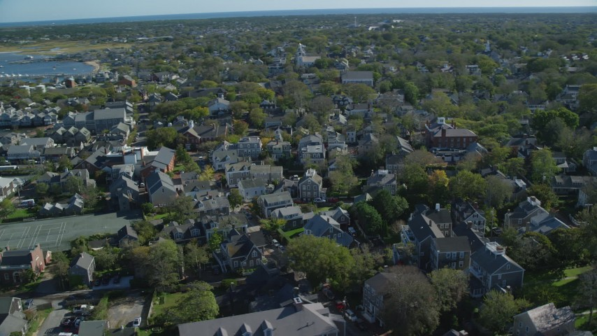 6K stock footage aerial video flying by small island town, coastal community, Nantucket, Massachusetts Aerial Stock Footage | AX144_093