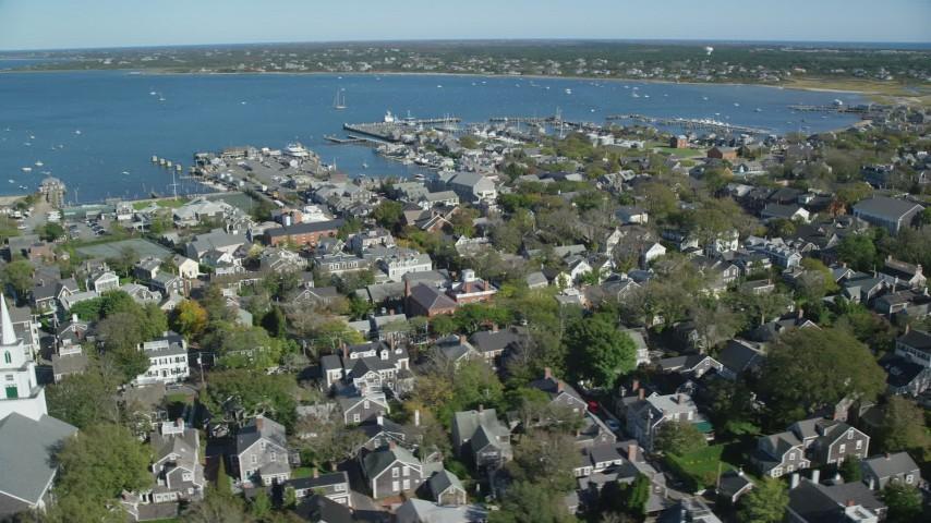 6K stock footage aerial video flying by small coastal community, Nantucket Harbor, Nantucket, Massachusetts Aerial Stock Footage | AX144_094