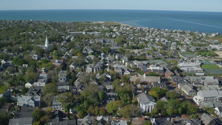 6K stock footage aerial video flying over small coastal community, harbor in the distance, Nantucket, Massachusetts Aerial Stock Footage | AX144_101