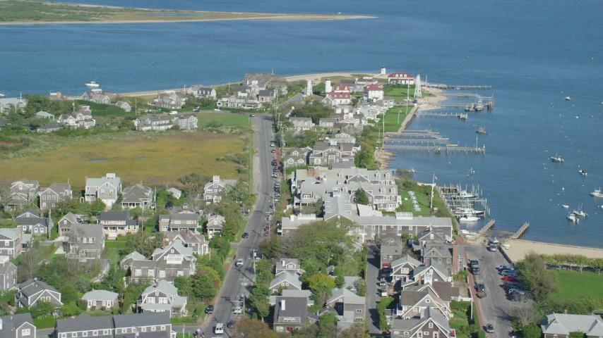 6K stock footage aerial video of a coastal community, Nantucket Harbor Range Lights, Nantucket, Massachusetts Aerial Stock Footage | AX144_103