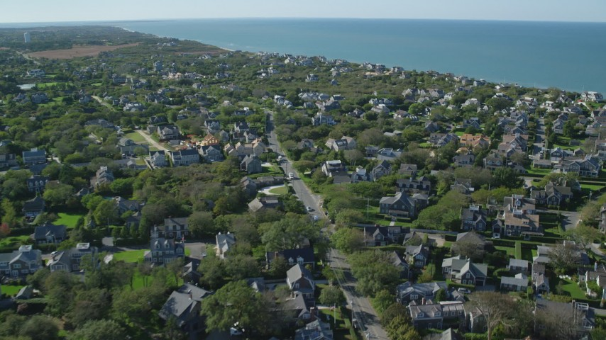 6K stock footage aerial video flying over small coastal community, upscale homes, Nantucket, Massachusetts Aerial Stock Footage   AX144_104