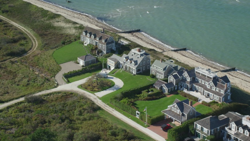 6K stock footage aerial video flying by beachfront upscale homes, tilt down, Nantucket, Massachusetts Aerial Stock Footage AX144_106
