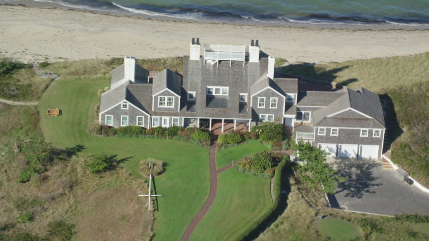 6K stock footage aerial video flying by upscale beachfront homes, tilt down, Nantucket, Massachusetts Aerial Stock Footage | AX144_107