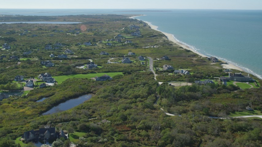6K stock footage aerial video flying over beachfront upscale homes, coastal community, Nantucket, Massachusetts Aerial Stock Footage   AX144_108