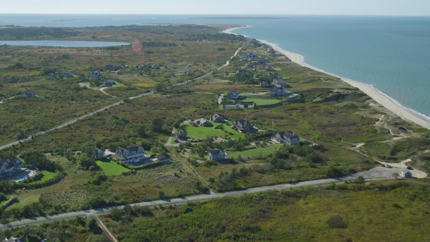 6K stock footage aerial video flying over upscale beachfront homes, coastal community, Nantucket, Massachusetts Aerial Stock Footage   AX144_109