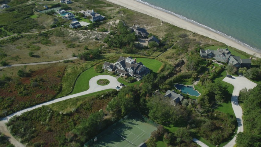 6K stock footage aerial video approaching upscale beachfront homes, tilting down, Nantucket, Massachusetts Aerial Stock Footage | AX144_112