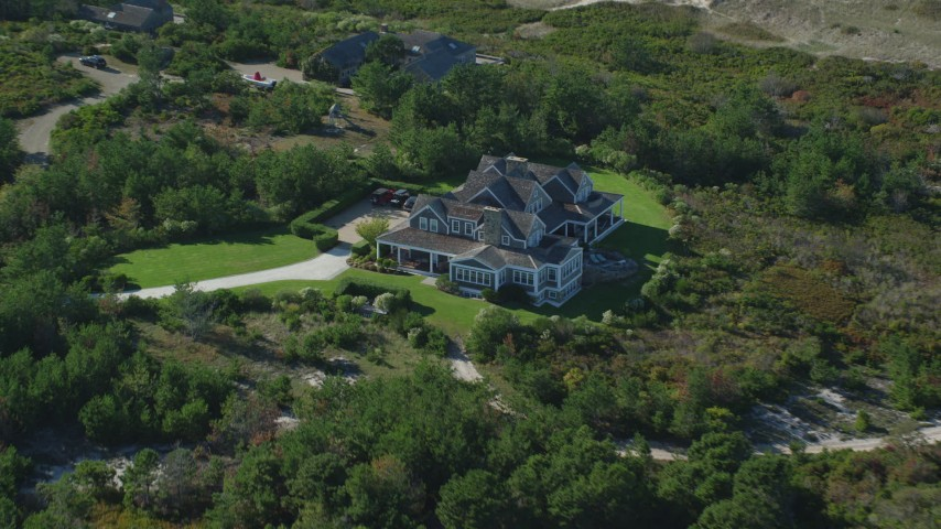 6K stock footage aerial video approaching upscale home, dense trees, Nantucket, Massachusetts Aerial Stock Footage   AX144_113