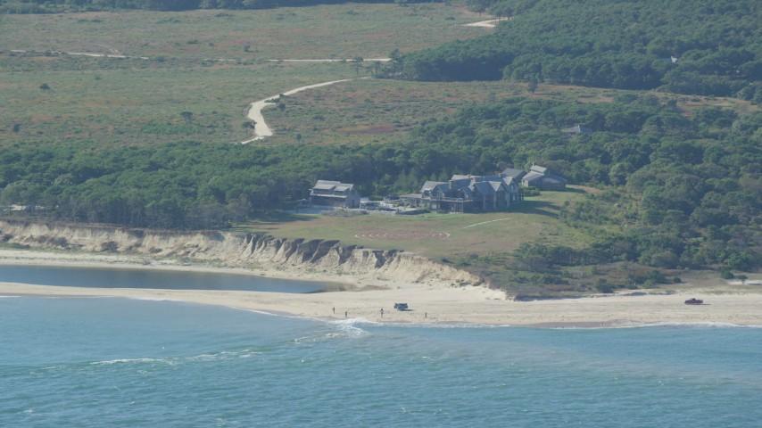 6K stock footage aerial video of an isolated beachfront mansion, Chappaquiddick Island, Martha's Vineyard, Massachusetts Aerial Stock Footage | AX144_123