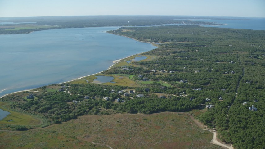 6K stock footage aerial video of homes near Katama Bay, Chappaquiddick Island, Martha's Vineyard, Massachusetts Aerial Stock Footage AX144_126 | Axiom Images