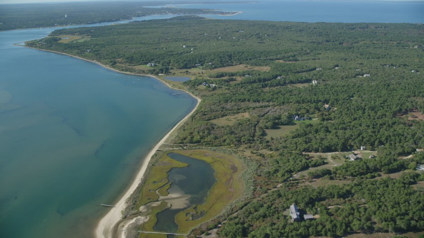6K stock footage aerial video of homes near Katama Bay, Chappaquiddick Island, Martha's Vineyard, Massachusetts Aerial Stock Footage | AX144_127