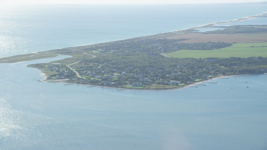 6K stock footage aerial video flying by coastal community, Edgartown, Martha's Vineyard, Massachusetts Aerial Stock Footage | AX144_128