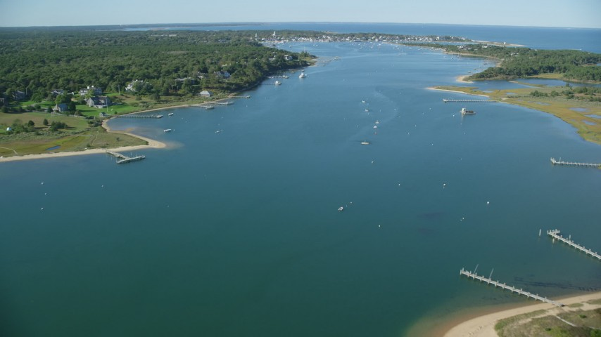 6K stock footage aerial video flying over Katama Bay, Edgartown, Martha's Vineyard, Massachusetts Aerial Stock Footage | AX144_130