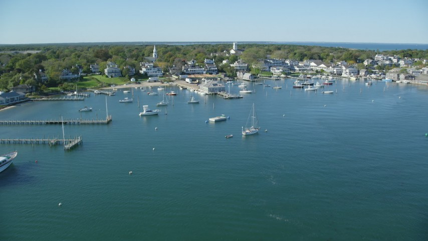 6K stock footage aerial video flying over moored boats, approaching Edgartown, Martha's Vineyard, Massachusetts Aerial Stock Footage | AX144_134