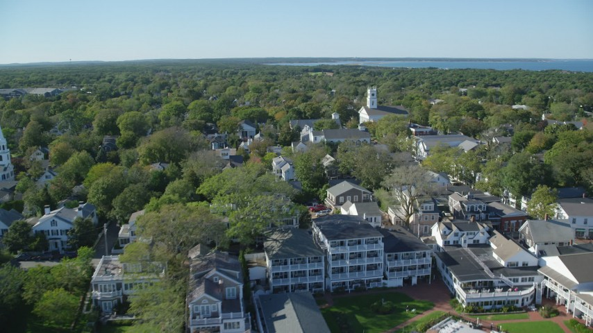 6K stock footage aerial video flying over boats, small coastal town, Edgartown, Martha's Vineyard, Massachusetts Aerial Stock Footage | AX144_135