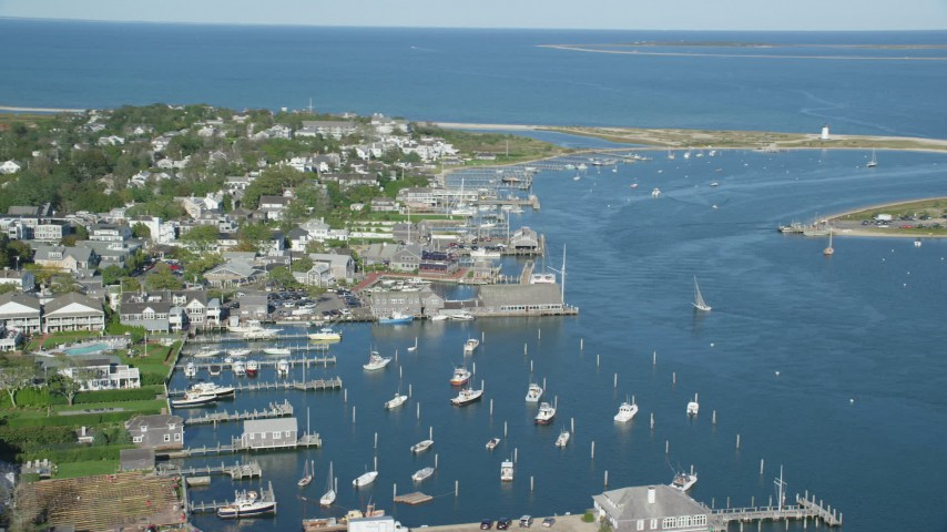 6K stock footage aerial video orbiting small coastal town, piers, Edgartown, Martha's Vineyard, Massachusetts Aerial Stock Footage | AX144_139