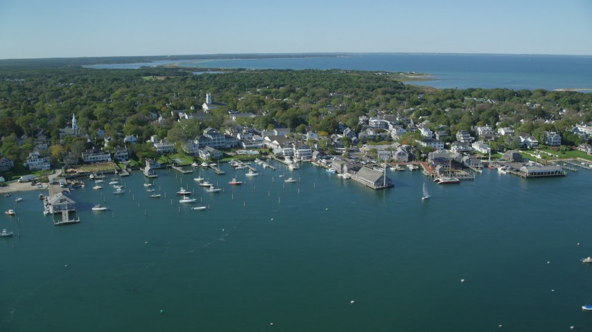 6K stock footage aerial video orbiting small coastal town, piers, Edgartown, Martha's Vineyard, Massachusetts Aerial Stock Footage | AX144_140