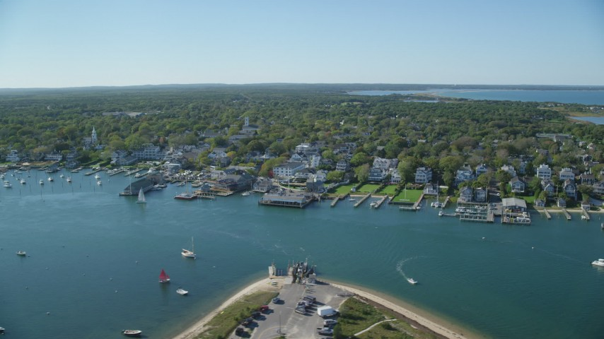 6K stock footage aerial video orbiting small coastal town, piers, Edgartown, Martha's Vineyard, Massachusetts Aerial Stock Footage | AX144_141