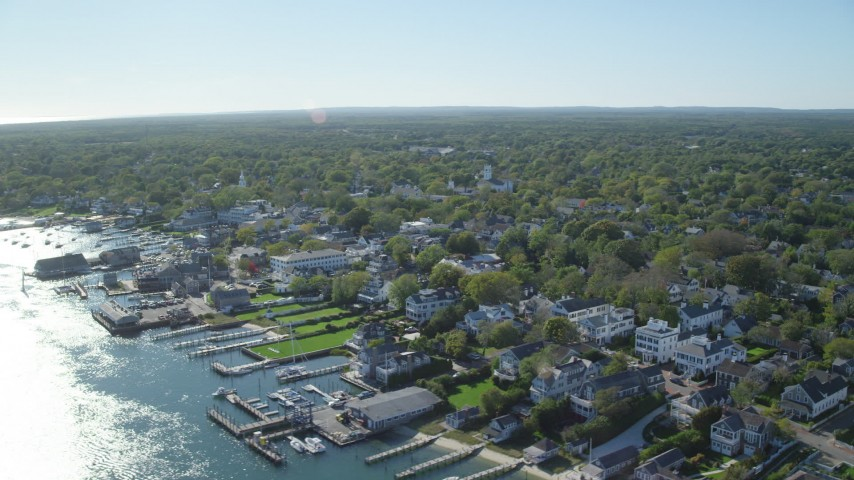 6K stock footage aerial video flying by small coastal town, Edgartown, Martha's Vineyard, Massachusetts Aerial Stock Footage | AX144_142