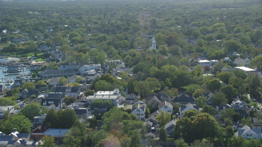 6K stock footage aerial video flying by small coastal town, Edgartown, Martha's Vineyard, Massachusetts Aerial Stock Footage | AX144_143