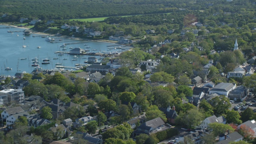 6K stock footage aerial video orbiting small coastal town, boats, Edgartown, Martha's Vineyard, Massachusetts Aerial Stock Footage | AX144_144