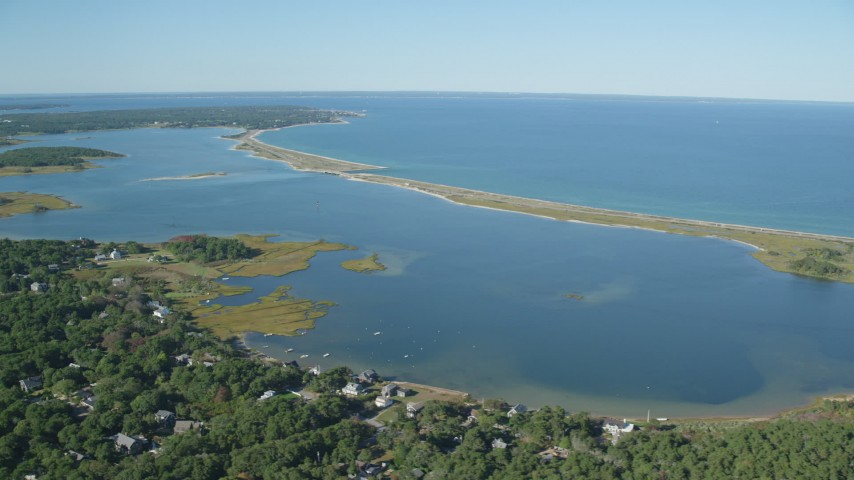 6K stock footage aerial video of Sengekontacket Pond, homes, Edgartown, Martha's Vineyard, Massachusetts Aerial Stock Footage | AX144_147