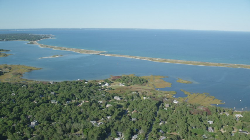 6K stock footage aerial video of waterfront homes near pond, Edgartown, Martha's Vineyard, Massachusetts Aerial Stock Footage | AX144_148